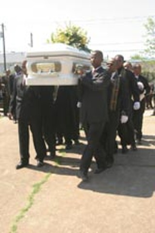 Dorothy Turner's casket is carried into the services.