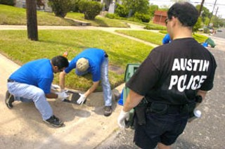 A 2005 Spring Spruce-Up Day event hosted by the city of Austin Neighborhood Housing and Community Development Department was held last Friday as part of the United Way's Day of Caring. City staff painted addresses on street curbs for homes in the Anderson Hill and Robertson Hill neighborhoods to help EMS, police, and fire vehicles to find homes more efficiently during times of emergency.