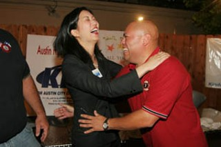 Place 3 City Council candidate Jennifer Kim celebrates with Austin Association of Professional Firefighters President Mike Martinez Saturday night. Thanks in part to the firefighters' endorsement, Kim qualified for next month's run-off against Margot Clarke.