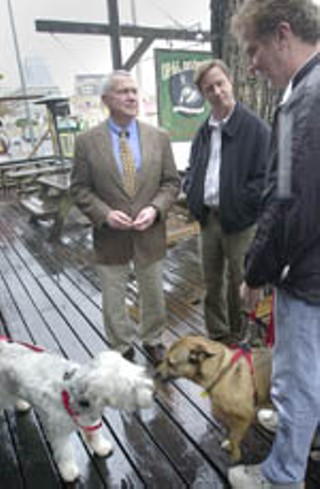 Council Member Lee Leffingwell chats with fellow dog-