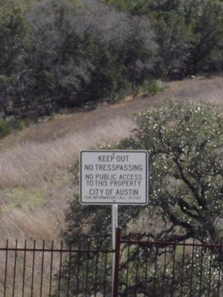 Signs warn the public away from the Balcones Canyonlands Preserve's songbird habitat
