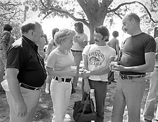 Young Ann Richards, 1977, with some Democratic activists and then-husband Dave Richards (at right)
