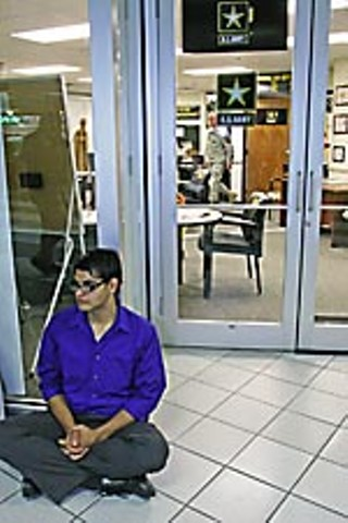 Jesus Sanchez engages in a sit-in at the military recruitment center at Dobie Mall.