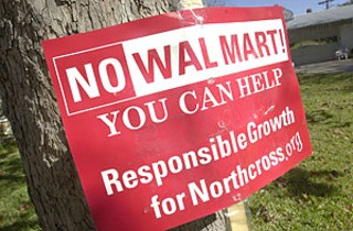 If anyone wonders what kind of reception Wal-Mart will receive in the Northcross Mall location, drive around Crestview, Allandale, and other surrounding neighborhoods, where these signs are sprouting up like weeds.