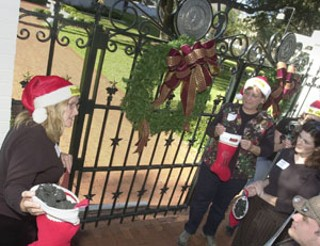 Karen Hadden and other activists with the Sustainable Energy and Economic Development Coalition attempt to deliver a Christmas stocking full of coal to the Governor's Mansion in protest of Gov. Rick Perry's support for 16 new coal-fired power plants in Texas.