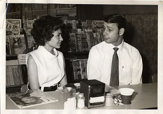 Lambert and Kathleen Labay seated at the Nau's soda fountain counter in the summer of 1971, just after they purchased the store from Hylton Nau and about six months before the birth of daughter Laura.