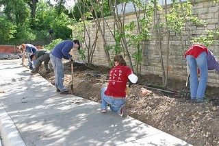 Friends of Deep Eddy landscaping volunteers at work outside the entryway to the restored bathhouse, May 2007