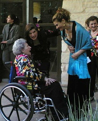 Lady Bird Johnson, with daughter Luci (center), greets Austin artist Ana Fuentes at the Lady Bird Johnson Wild Flower Center Gala in May.
