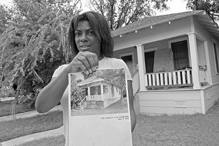 Sewah Archer holds a photo of what this Juniper Street home looked like before she invested thousands toward restoration – only to be told she was no longer eligible for the ARA home.