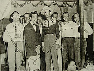 Hank Williams at Dessau Hall, 1950:  Jimmy Grabowske stands to Williams' immediate left, back row.