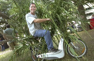 Weirdest commuter winner Tiger Davis, with his bamboo-covered electric scooter, took top billing at a Sept. 28 awards fest sponsored by the Commute Solutions Coalition of Central Texas.