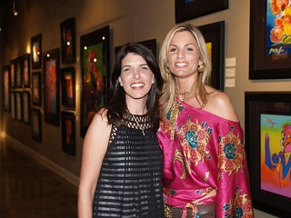 "Lisa Russell (l), owner of the Russell Collection Fine Art Gallery, and ""Best of Austin"" award-winning event planner Suzanne Court at Russell's Peter Max exhibition"