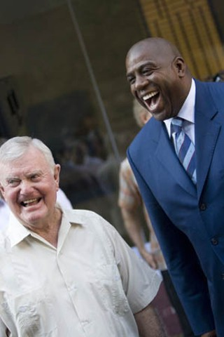 Sports legends Darrell K. Royal (l) and Magic Johnson at the groundbreaking ceremony for the new W Hotel on Second Street