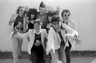 Posing for Band of the Year in 1986 with some of the Trash crew (l-r rear): John Mills, Kari Puckett, Dino Lee, Margaret Moser, Troy Dillinger; front: Mike English, Hector Muñoz.