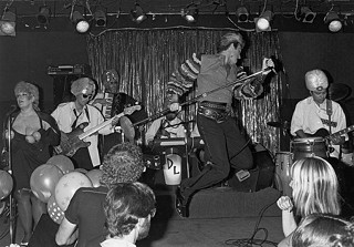 Dino Lee takes a flying leap onstage at Fitzgerald's in Houston, where the White Trash Revue got banned because the audience stripped naked, 1985.