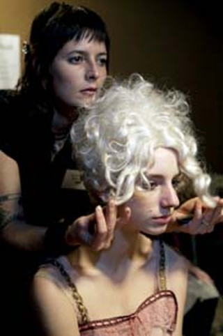 A stylist from method.hair perfects a powdered wig for the Louise Black collection<p>Photo courtesy of Jody Horton