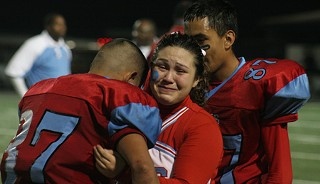 Johnston senior Gabby Camarillo consoles Art Jimenez after the Ram's homecoming game loss to Lanier. The Rams were forced to forfeit much of the season due to injuries and academic disqualifications.