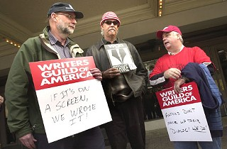 Local scribes (l-r) Stephen Harrigan, Turk Pipkin, and Tim McCanlies gathered outside the Paramount Theatre last Thursday to protest for writers' rights.