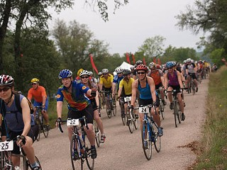 Enthusiastic riders raise money while biking through glorious wildflower country at last year's Hill Country Ride for AIDS.