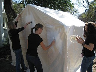 Students at Khabele School in Austin prepare a Tent of Hope for painting.