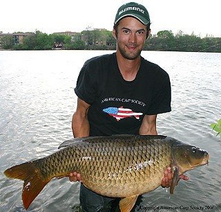 Al St. Cyr and the state-record setting carp he caught in then-Town Lake