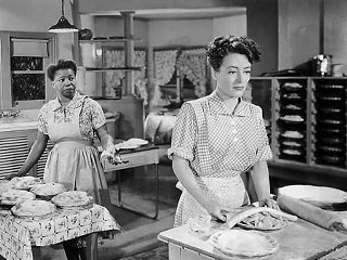 Butterfly McQueen (l) and Joan Crawford in Warner Bros.' <i>Mildred Pierce</i>