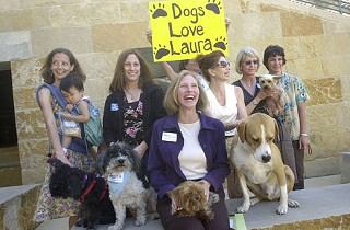Dogs, dog lovers, and dog-loving City Council candidates gathered outside City Hall Wednesday as <a href=http://fixaustin.org/><b>FixAustin.org</b></a> released its report card on the council contenders (see <b><a href=http://www.fixaustin.org/>www.fixaustin.org</a></b> for results). Two of the group's favored candidates – Laura Morrison (seated) and Randi Shade – attended the event.