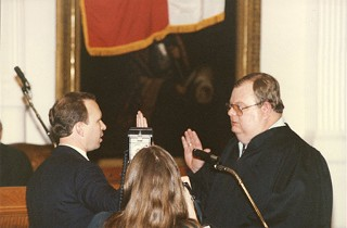 Baird taking his oath of office in 1990