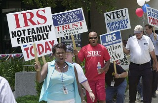 IRS employees, members of Chapter 2-47 of the National Treasury Employees Union, protested Tuesday to shed light on their boss' refusal to allow adequate family-leave time for workers.