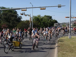 Critical Mass adds bareheaded bikers to the Friday rush-hour melee.