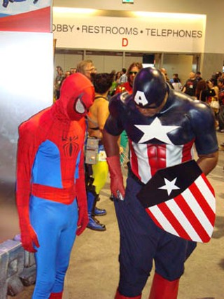 Spidey and Captain America compare shoe sizes.
