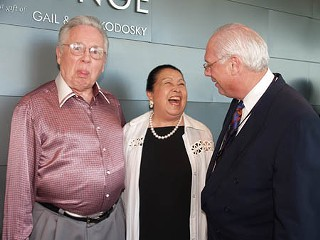 Joe R. and Teresa Lozano Long (l and c) share a moment of humor with Cliff Redd at the Catalyst Eight benefit  for the Long Center.