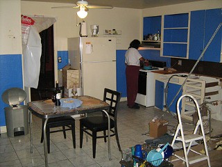 Cooking in the old kitchen for the last time. Only half the cabinets remained. The sink was gone.
