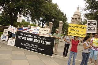 Death penalty opponents rally Tuesday outside the Capitol.