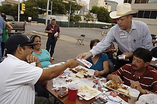 Democrat Larry Joe Doherty (in cowboy hat) pitches his candidacy to union members at this year's AFL-CIO Labor Day Fish Fry in Austin.