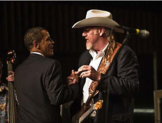 Big Wheel keeps on turnin': President-elect Barack Obama (l) and Ray Benson at the Austin Music Hall, Feb. 21