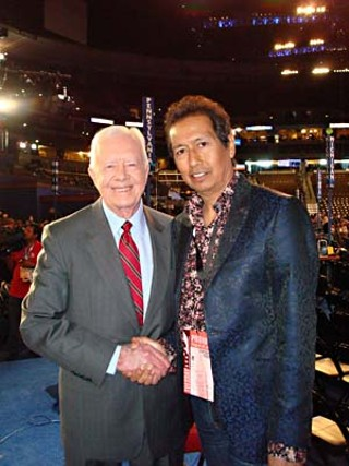Former President Jimmy Carter and Alejandro Escovedo (r)