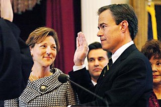With his wife, Julie Brink Straus, by his side, two-term state Rep. Joe Straus, R-San Antonio, was sworn in Tuesday by Chief Justice Wallace Jefferson as the new speaker of the Texas House. In his opening remarks to members, Straus, who won by acclamation, promised to create an atmosphere where everyone's voice can and will be heard. (See <a href=http://www.austinchronicle.com/gyrobase/Issue/story?oid=oid%3A726736><b>A New Day</b></a> for more photos.) – <i>Richard Whittaker</i>