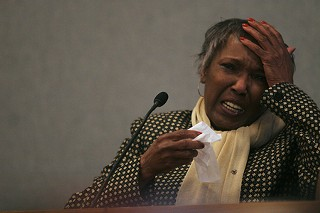 Ruby Session, mother of Timothy Cole, cries on the witness stand last week in a Travis Co. courtroom.