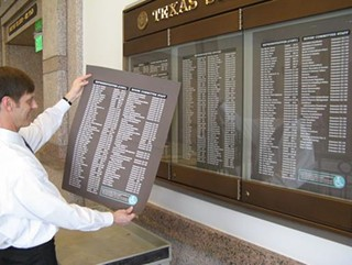 Sign o' the Times: New committee listings go up in the Capitol