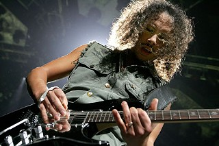 Riding the lightning: Metallica's Kirk Hammett at the Toyota Center in Houston, Nov. 20, 2008