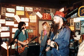 Timbuk 3's Pat MacDonald and Barbara K with Blaze Foley at the Austin Outhouse.