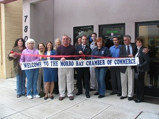 Lynch (center, with scissors) outside his dispensary, with Morro Bay, Calif. mayor and Chamber of Commerce