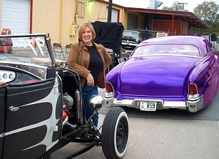 I not-so-secretly heart custom cars. That's me with Shaun Young's roadster and Mercury Charlie's award-winning Nadine at the Hotrods-n-Honeys party last November