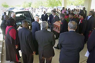Pallbearers carry the casket of Nathaniel Sanders II at funeral services Monday for the 18-year-old, who was killed May 11 by an Austin police officer The shooting remains under an investigation.