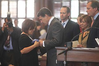 Gov. Rick Perry and state lawmakers paid tribute to families of fallen soldiers in a special ceremony May 30.