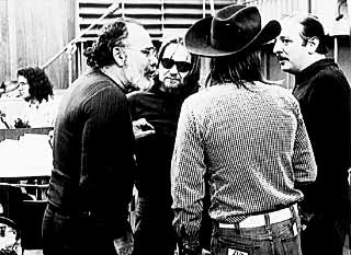 Wexler confers with  Willie Nelson (sunglasses)  and Arif Mardin (r).