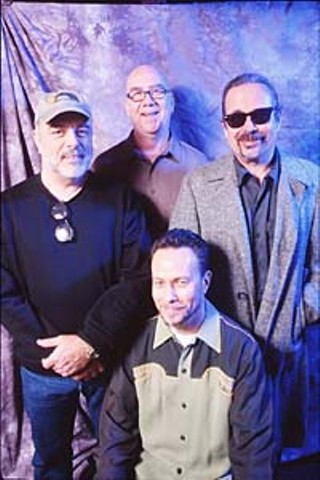 Blue Monday Band, 2000 (l-r):  Riley Osborn, George Rains,  Roscoe Beck, and Derek O'Brien