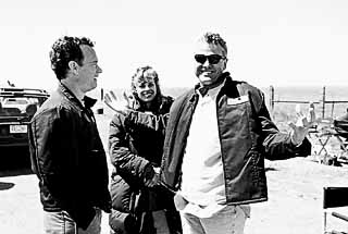 This movie begins and ends in Texas, says Broyles, here with his wife Andrea and Hanks in Canadian, Texas, where <i>Cast Away</i>'s bookend scenes were shot. And that's no accident. This is where my heart is.<br>(photo courtesy Bill Broyles)