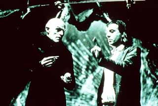 Director E. Elias Merhige (r) and Willem Dafoe on the set of <i>Shadow of the Vampire</i>, opening Jan. 26.